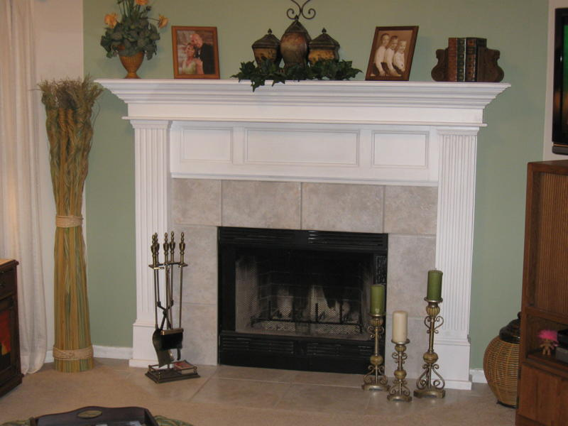 This lovely fireplace mantel serves as a centerpiece to the handcrafted